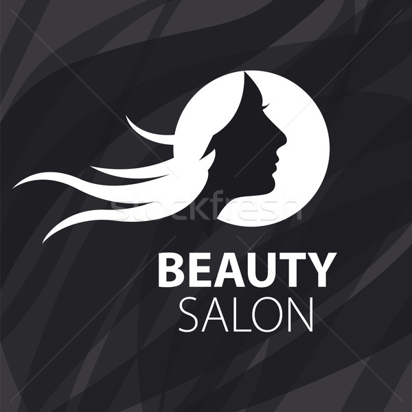 vector logo girl with flying hair on a black background Stock photo © butenkow