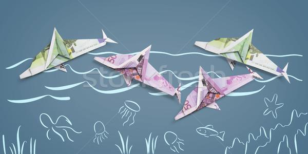 Origami dolfijn bankbiljetten uit geschilderd zee Stockfoto © butenkow