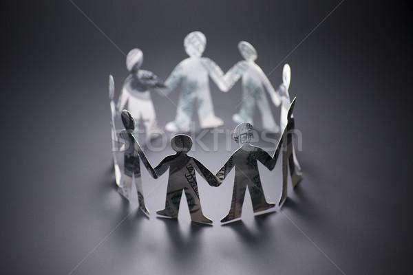 люди оригами банкнота , держась за руки бумаги Сток-фото © butenkow