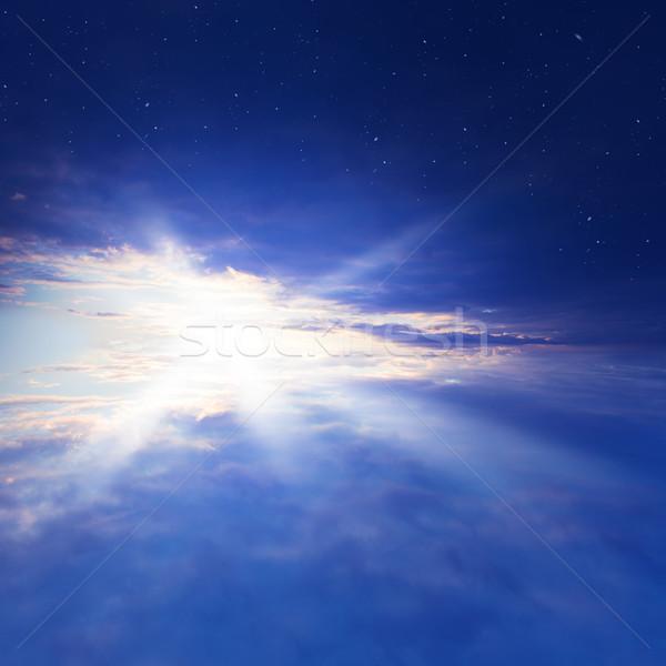 Güneş rays gün batımı bulutlar Yıldız gökyüzü Stok fotoğraf © butenkow