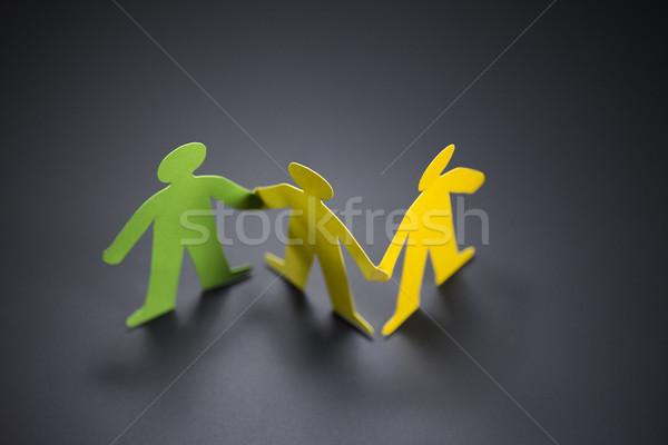 Persone origami carta holding hands buio mani Foto d'archivio © butenkow