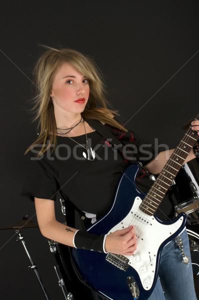 Estrela do rock jogar guitarra mulher música olhos Foto stock © BVDC
