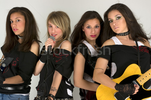 Rock band bella compongono donna musica chitarra Foto d'archivio © BVDC