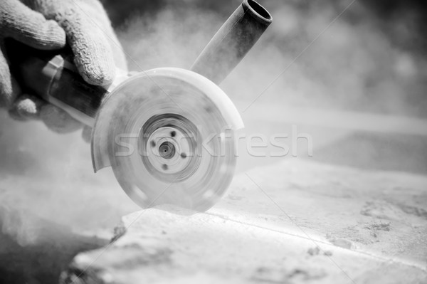 Grinder worker cuts a stone Stock photo © byrdyak
