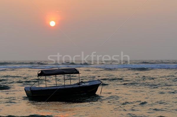 Tropicali tramonto bella barca spiaggia sole Foto d'archivio © byrdyak