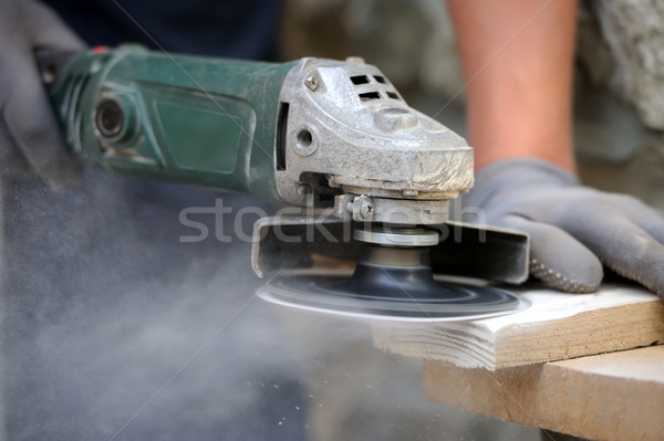 Worker polishing a wood table Stock photo © byrdyak