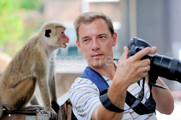 Photographer shows a monkey Stock photo © byrdyak