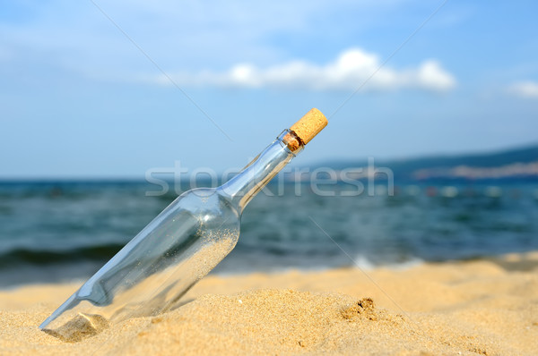 Stock photo: Message in the bottle from ocean