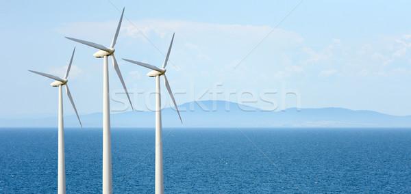 Szélturbina öko erő szélturbinák tájkép tenger Stock fotó © byrdyak