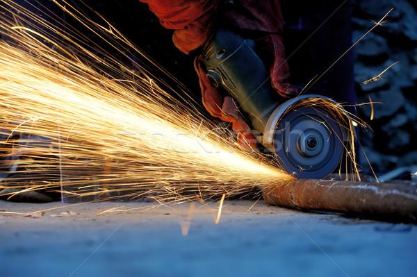 Munkás vág fém daráló szikrák munka Stock fotó © byrdyak