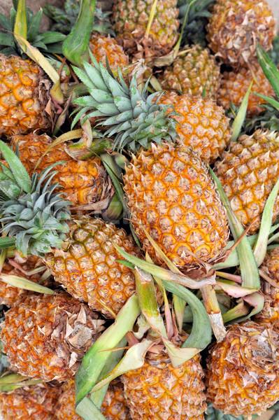 Lot of pineapple fruit background Stock photo © byrdyak