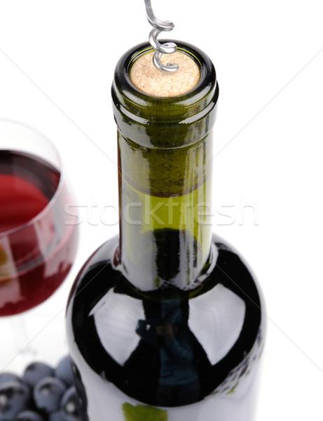 Bottiglia di vino vetro uve isolato bianco alimentare Foto d'archivio © byrdyak