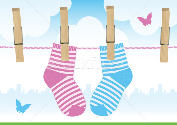 Stock photo: Vector illustration of a line with clothespins and baby socks.
