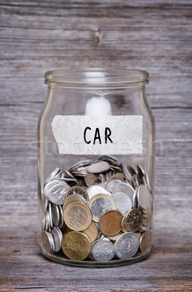 car, money jar with coins on wood table Stock photo © c12