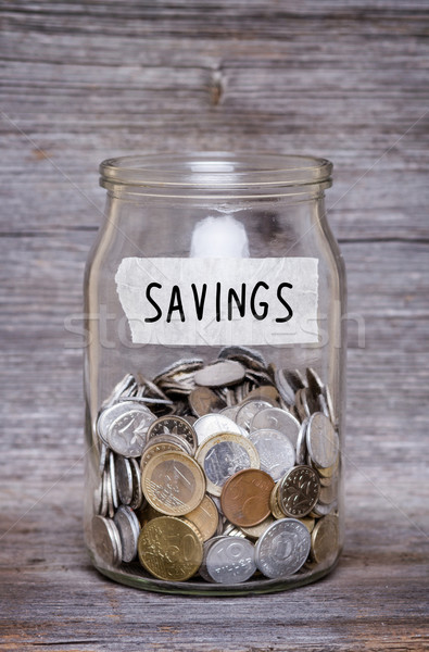 Poupança dinheiro jarra moedas mesa de madeira negócio Foto stock © c12