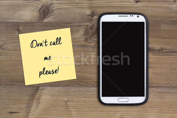 dont call me please message, smart phone and sticky note on wood Stock photo © c12