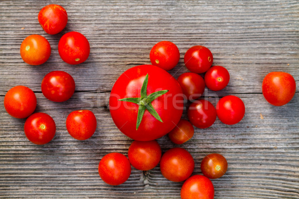 fresh red delicious tomatoes on an old wooden tabletop Stock photo © c12