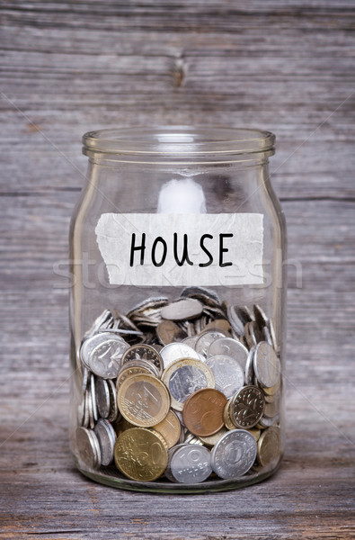house, money jar with coins on wood table Stock photo © c12