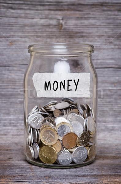 Dinheiro jarra moedas mesa de madeira negócio madeira Foto stock © c12