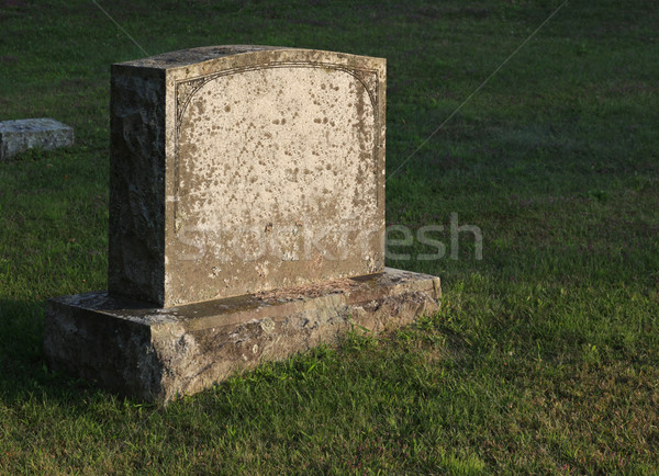 Sun-cast Tombstone