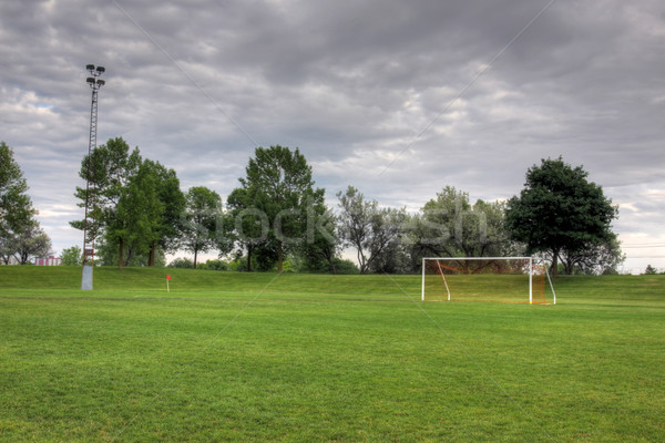 Stock photo: Cloudy Soccer Field