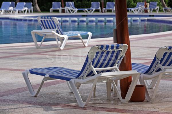 üdülőhely medence társalgó székek ül vmi mellett Stock fotó © ca2hill