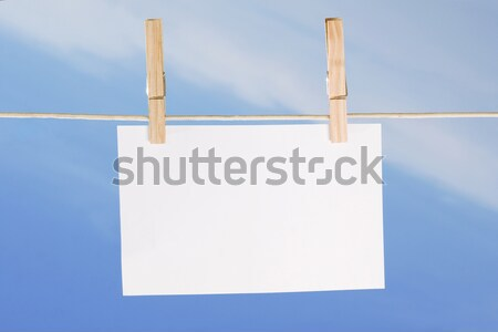 blank paper and clothes peg on blue sky Stock photo © caimacanul