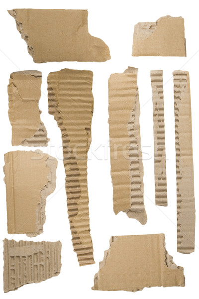 Pieces of torn brown corrugated cardboard Stock photo © caimacanul