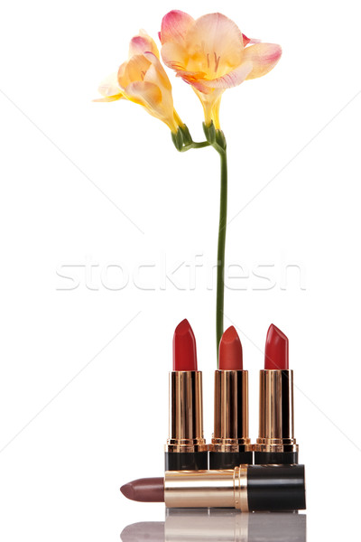 glamor red shiny lipstick and yellow flower Stock photo © caimacanul
