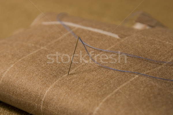 needle and thread on fabric background Stock photo © caimacanul
