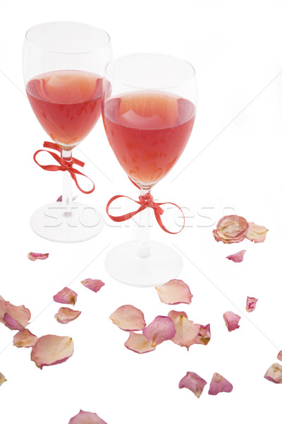 two red wine and rose petals Stock photo © caimacanul