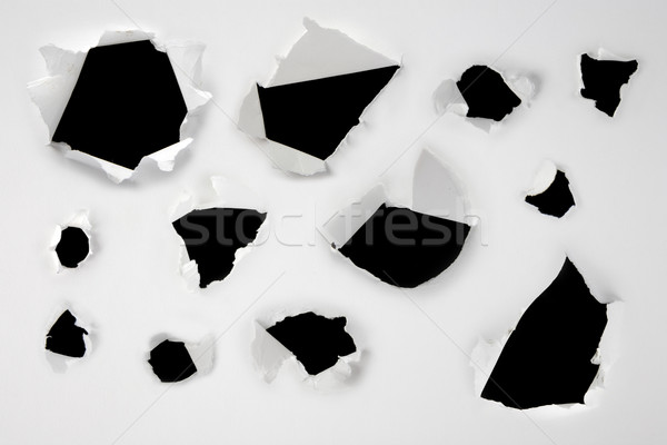 Closeup of a dark holes on white paper set Stock photo © caimacanul