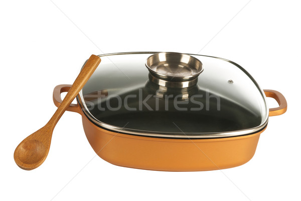 cookware, nonstick pan and wooden spoon Stock photo © caimacanul