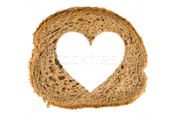 Heart shaped hole in a slice of bread Stock photo © caimacanul