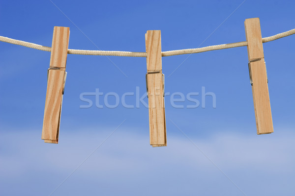 clothesline and pegs on blue sky background Stock photo © caimacanul