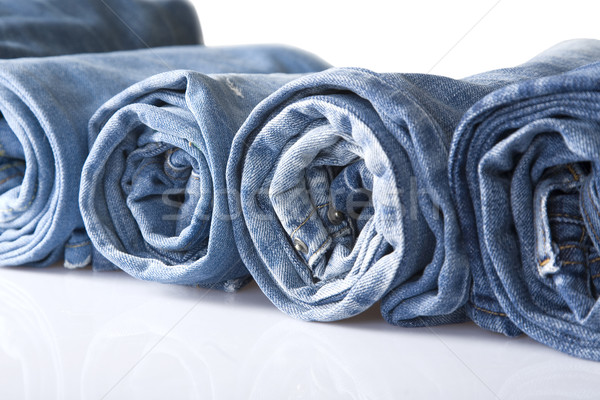 Rollen Blauw denim jeans lijn geïsoleerd Stockfoto © caimacanul