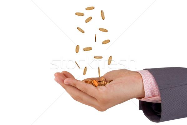 Eller düşen madeni para adam yalıtılmış beyaz Stok fotoğraf © caimacanul