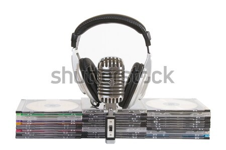 Front view of headphones, vintage microphone, cd, dvd Stock photo © caimacanul