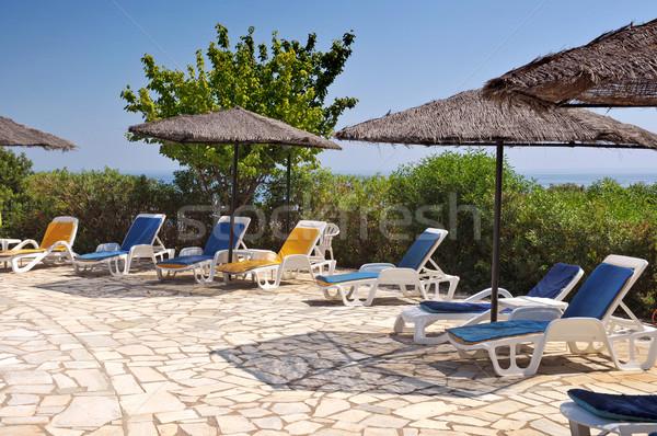 Hotel piscina sol mar jardín verano Foto stock © Calek