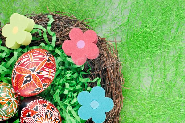 Huevos Pascua pintado nido flores feliz Foto stock © Calek