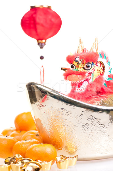 Dragon on large gold ingot and hanging lantern Stock photo © calvste