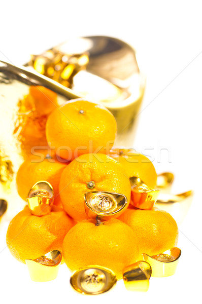 Tangerines and gold ingots close up Stock photo © calvste