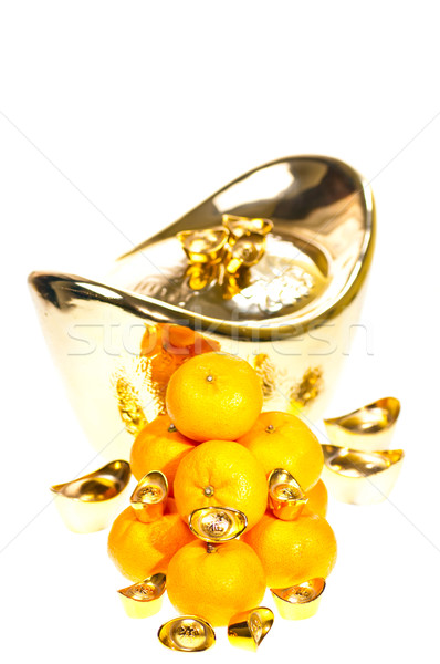 Gold ingots and tangerines close up over white Stock photo © calvste