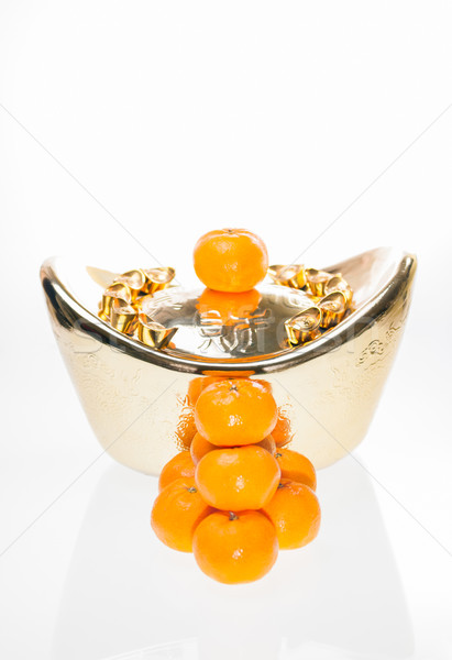 Plump mandarin oranges with large ingot background Stock photo © calvste