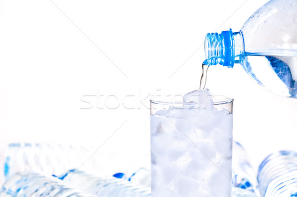 Glass of ice water being filled Stock photo © calvste