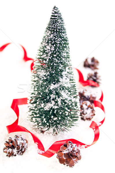Mini Christmas tree with pinecone on snow Stock photo © calvste