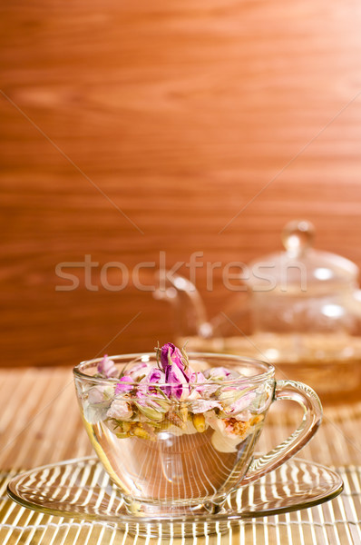 Pink rose tea in a glass teacup close up Stock photo © calvste