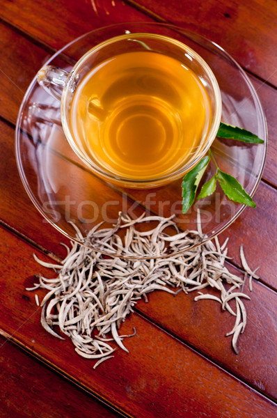 Cup of silver tips tea on a wooden table Stock photo © calvste