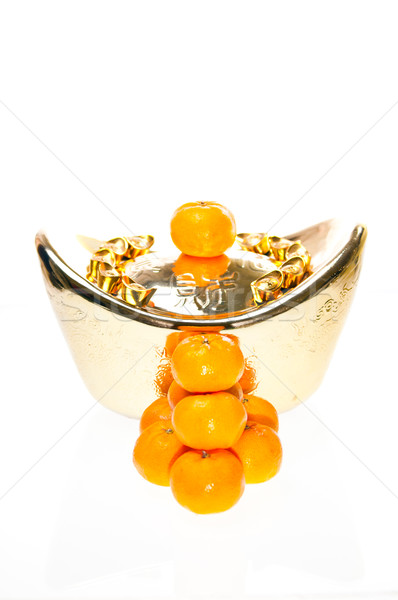 Tangerine with ingot background Stock photo © calvste