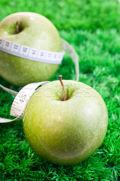 Two apples on grass with tape measure Stock photo © calvste